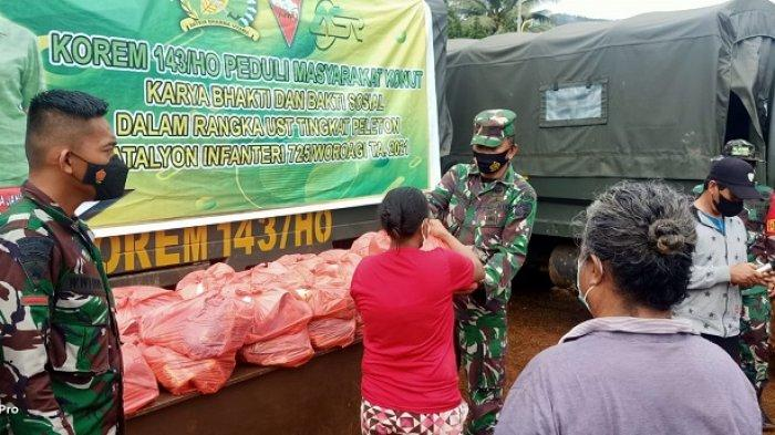 Usai Latihan Tempur TNI-AD Yonif 725/Woroagi Bagikan Bansos Dan Karya Bakti