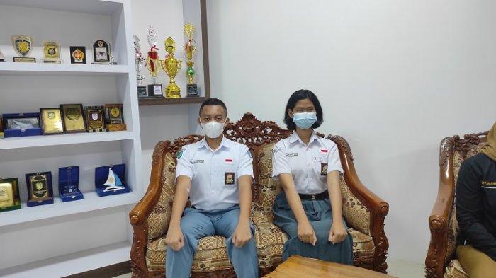 Profil Ainun Jariah Ismail (kanan) yang merupakan Paskibraka 2021 asal SMK 3 Baubau, Provinsi Sulawesi Tenggara, di Istana Merdeka.