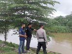 personel-polsek-wonggeduku-pantau-kondisi-air-sungai-konaweha.jpg