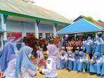 polres-konawe-menggelar-vaksinasi-covid-19-di-sma-negeri-1-wawotobi-kabupaten-konawe.jpg
