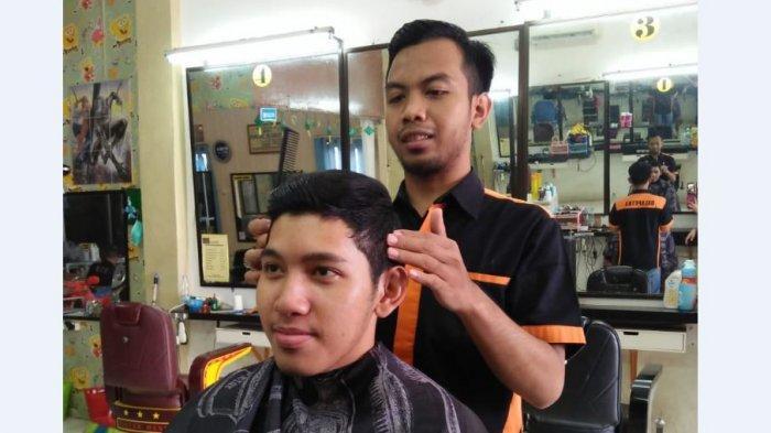 Pemegang Tribun Family Card Gratis Enam Kali Potong Rambutdi Barbershop Balaputra Palembang