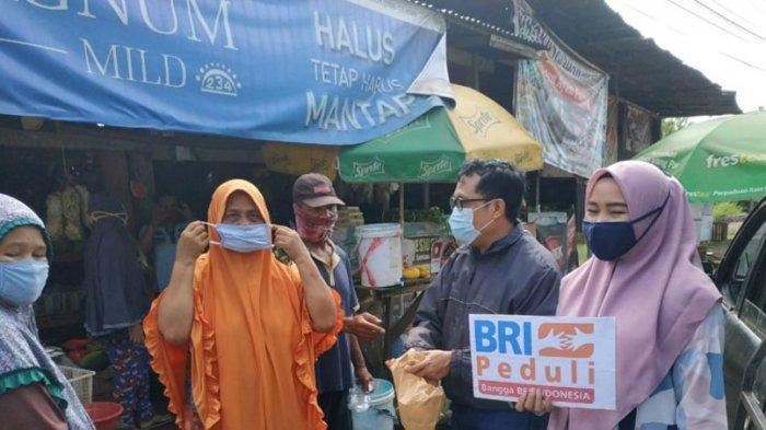 Kanwil BRI Palembang Salurkan 42.120 Masker Bagi Pedagang Pasar