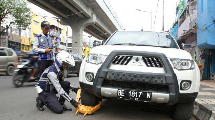 Dishub Kota Palembang Bakal Tertibkan Jukir Pungut Parkir di Depan Minimarket