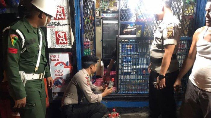 Operasi Gabungan Polsek Lawang Kidul Sita Puluhan Botol Minuman Keras