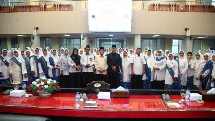 Hj Halifah Mahyuddin Lantik Kepengurusan BKMT Kota Palembang Periode 2019-2024