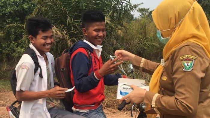 Dinas Kesehatan Muaraenim Bagikan 1.000 Kotak Masker di 5 Kecamatan