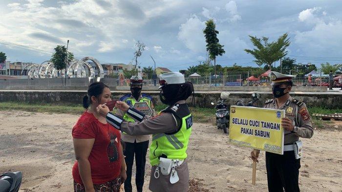Polres Ogan lIlir Kampanyekan Protokol Kesehatan di Taman Pancasila Indralaya