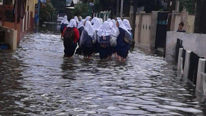 Dinas Pendidikan Palembang Instruksi Kegiatan Belajar Mengajar Dihentikan Sampai Banjir Mereda