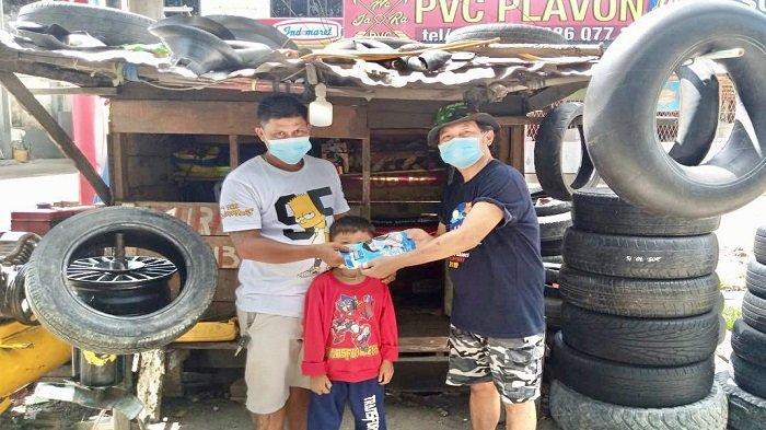 Cara SOKSI Sumsel Ikut Putus Rantai Penyebaran Covid-19, Sebar Ratusan Masker ke Pekerja Bengkel