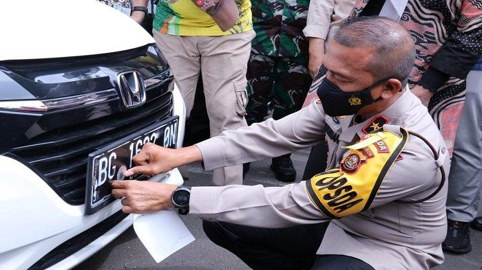 Wakapolda Sumsel Menghadiri Launching Pemasangan Sticker Tanda Lunas Pajak Ranmor