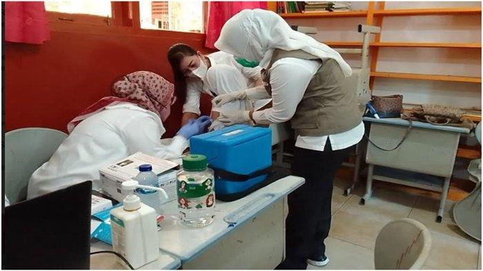 Wawako Palembang Fitrianti Pantau Vaksinasi di SMPN 13 Palembang, Ada 9 Sekolah Gelar Vaksinasi