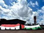 act-mri-palembang-gelar-aksi-kibarkan-bendera-raksasa-palestina-indonesia-di-bkb.jpg