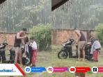 aksi-kakak-menjemput-adiknya-saat-hujan-deras.jpg