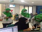 aktivitas-petugas-bpjs-satu-di-kantor-bpjs-kesehatan-cabang-palembang.jpg