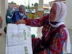 bukti-pembayaran-biaya-pengurusan-sertifikat-65-warga-desa-sinar-harapan.jpg