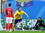 emil-forsberg-merayakan-gol-swedia-ke-gawang-swiss_20180703_231612.jpg
