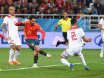 gelandang-timnas-spanyol-isco-mencetak-gol-ke-gawang-maroko_20180626_062013.jpg