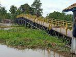 jembatan-serigeni-oki-putus-1.jpg