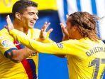 para-pemain-barcelona-luis-suarez-dan-antoine-griezmann-melakukan-selebrasi-usai-mencetak-gol.jpg