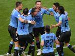 para-pemain-timnas-uruguay-saat-merayakan-gol-kedua-timnya-ke-gawang-rusia_20180625_230554.jpg