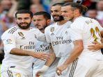 pemain-real-madrid-berselebrasi-usai-berhasil-mencetak-gol-dalam-lanjutan-pertandingan-liga-spanyol.jpg