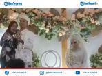 pengantin-lelaki-berfoto-mesra-tinggalkan-pengantin-perempuan-duduk.jpg