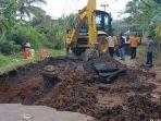 perbaikan-jalan-putus-di-desa-belatung-kecamatan-lubuk-batang-kabupaten-ogan-komering.jpg