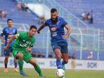 pertandingan-antara-arema-fc-vs-bhayangkara-fc-di-liga-1-indonesia-2.jpg