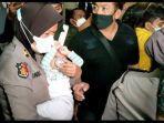 polisi-amankan-bayi-yang-diculik-seorang-art.jpg