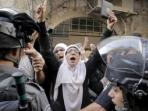polisi-israel-menghalangi-para-perempuan-palestina_20150914_095636.jpg