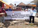 ptba-serahkan-bantuan-kepada-korban-banjir-bandang-di-desa-ujanmas-baru.jpg