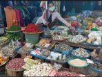 rani-20-pedagang-di-pasar-tradisional-martapura-oku-timur-jumat-242021.jpg