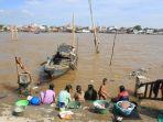suasana-air-pasang-di-kawasan-sungai-musi-palembang-rabu-2832018_20180329_043019.jpg
