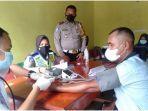 suntik-vaksin-di-dusun-2-musi-landas-kecamatan-sembawa-kabupaten-banyuasin-jumat-2492021.jpg