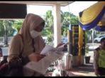 tangis-ibu-muda-di-stasiun-ka-kertapati-jumat-752021.jpg