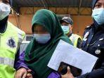 tersangka-pembunuhan-siti-nur-surya-ismail-19-dibawa-pihak-berwajib-malaysia.jpg