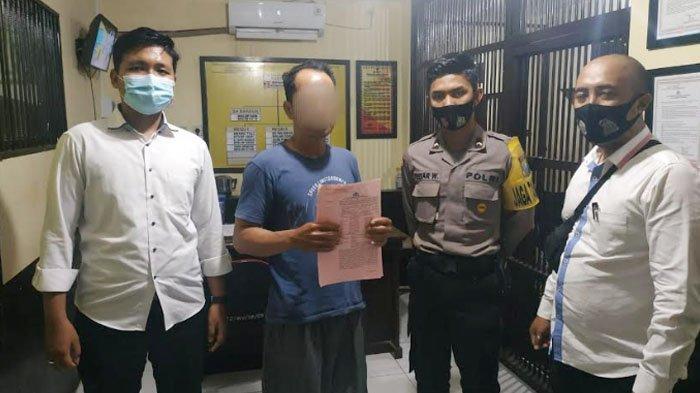 Sj saat akan menjalani penahanan di Mapolres Tulungagung.