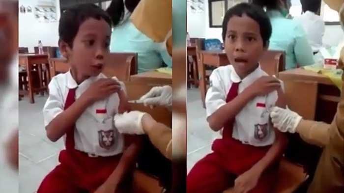 VIDEO : Bocah SD ini Tunjukkan Ekspresi Kocak Saat Diimunisasi di Sekolah, Ucapannya Bikin Ngakak!