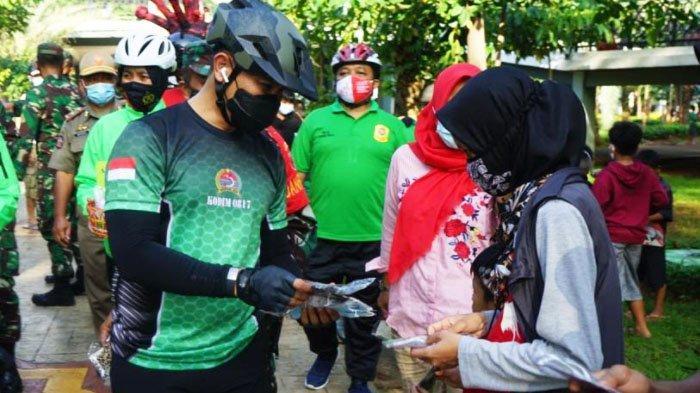 Dandim Gresik Gowes Bareng Komunitas sambil Bagi-bagikan Masker dan Gelar Rapid Test Gratis