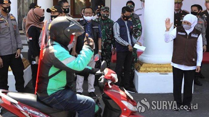 Ratusan Driver Ojek Dapat Bantuan Partisi dari Forkopimda Jawa Timur untuk Cegah Penularan Covid-19