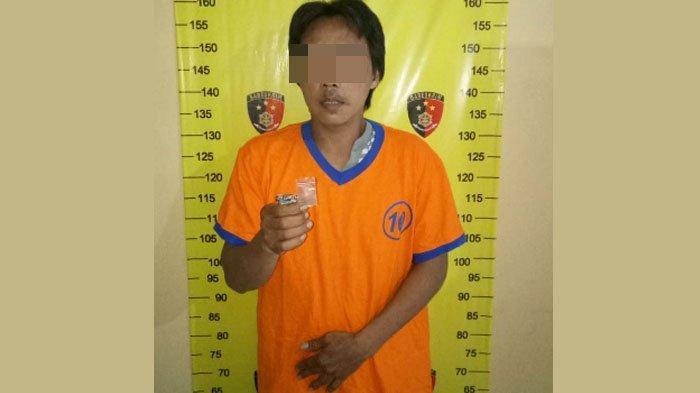 Eko saat diamakan di Mapolsek Wonokromo Surabaya.