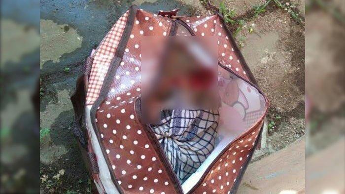 Jenazah bayi perempuan yang ditemukan dalam tas dan mengambang di di aliran sungai Jalan Simpang Kepuh RT 10 RW 4, Kelurahan Bandungrejosari, Kecamatan Sukun, Kota Malang, Selasa (20/4/2021) pagi.