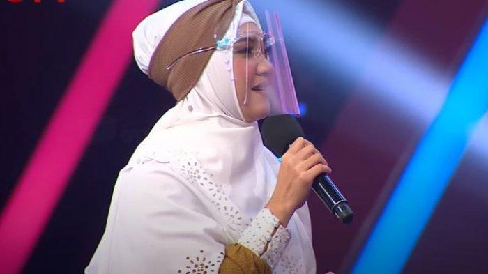 Lirik Ummi - Sulis feat Hadad Alwi dengan Tulisan Latin dan Artinya, Ummi Yaa Lahnan A'syaqohu