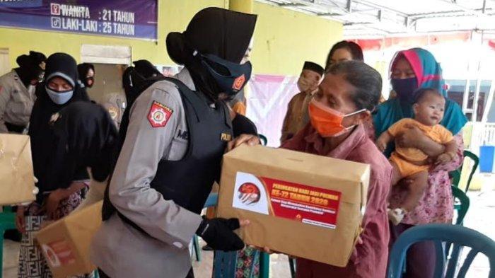 HUT Polwan ke-72, Polwan di Bondowoso Bagi-bagi Sembako dan Masker