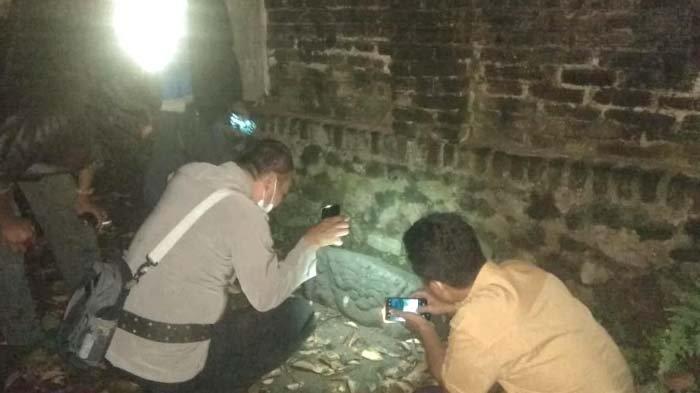 PolisiAmankan Benda Diduga Cagar Budaya Ditemukan Warga saat Bersih-bersihSungai di Kediri