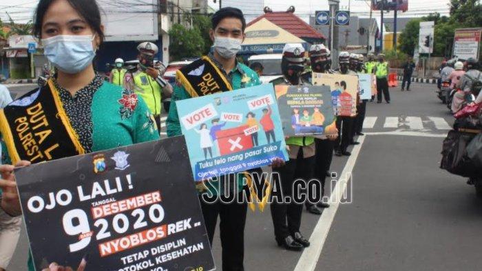 Polwan Sidoarjo Ajak Warga Datang ke TPS saat Pelaksanaan Pilkada 9 Desember 2020