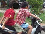 2-bocah-nekat-kendarai-motor-plat-merah-tanpa-helm-bikin-polisi-prihatin-kasus-lain-berujung-maut.jpg