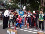 aksi-galang-dana-komunitas-superhero-beramal-surabaya-di-taman-bungkul.jpg