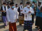 anggota-bawaslu-ri-mochammad-afifuddin-kanan-saat.jpg