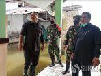 anggota-komisi-c-dprd-sidoarjo-saat-sidak-ke-lokasi-banjir-di-kecamatan-tanggulangin.jpg